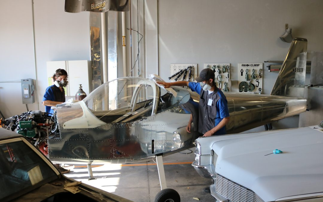 Auto Collision students paint airplane for teen aircraft builders